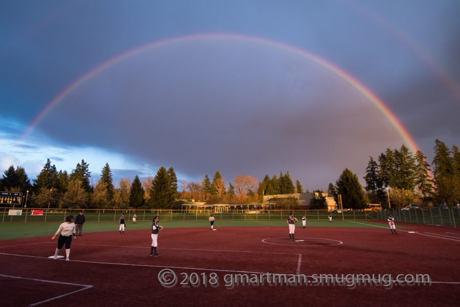 Girls softball plays under lucky rainbow. But the rainbow wasnt enough to capture the win.