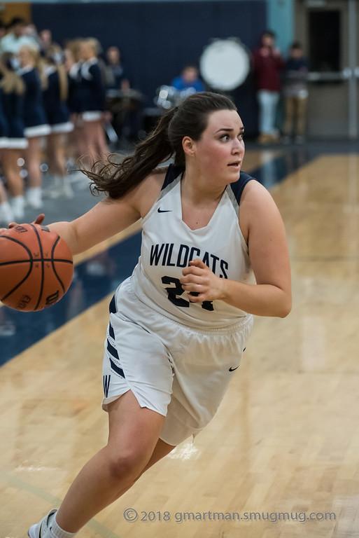 Senior Jessica Classen drives toward the basket.