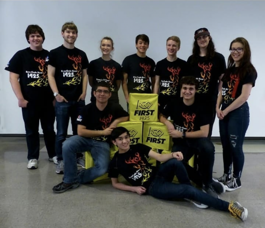 The robotics team poses for a photo at .a meeting. The team is getting ready for their competition season.