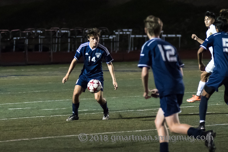 Sam Blohn controls the ball in a home game against Forest Grove