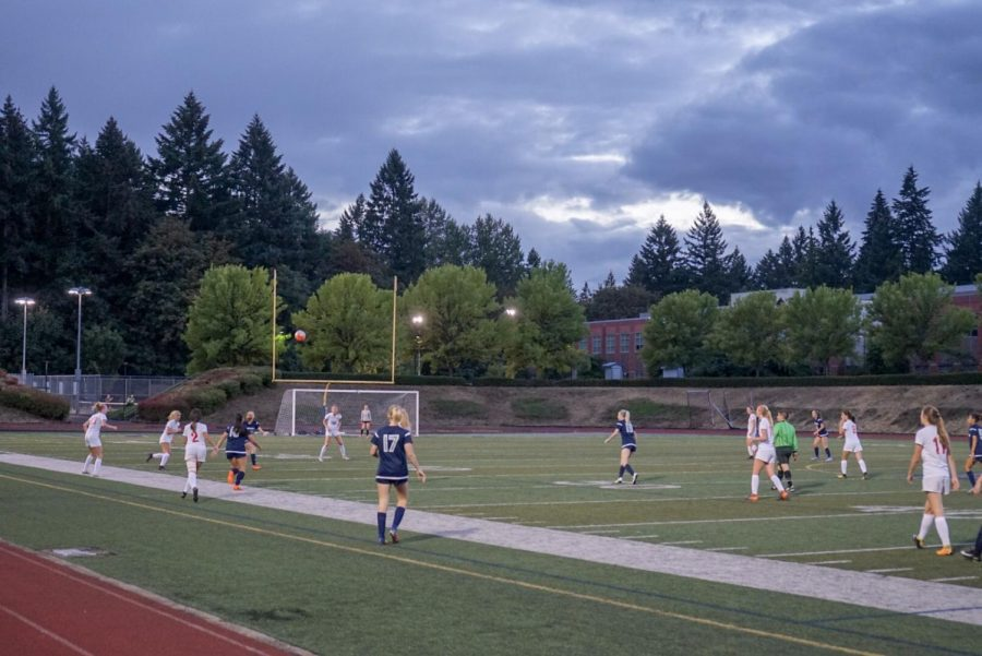 Girl's varsity soccer game at Randall Stadium during the preseason. Wildcats and Cardinals prepare themselves to contest the ball as it is seen coming down to earth.