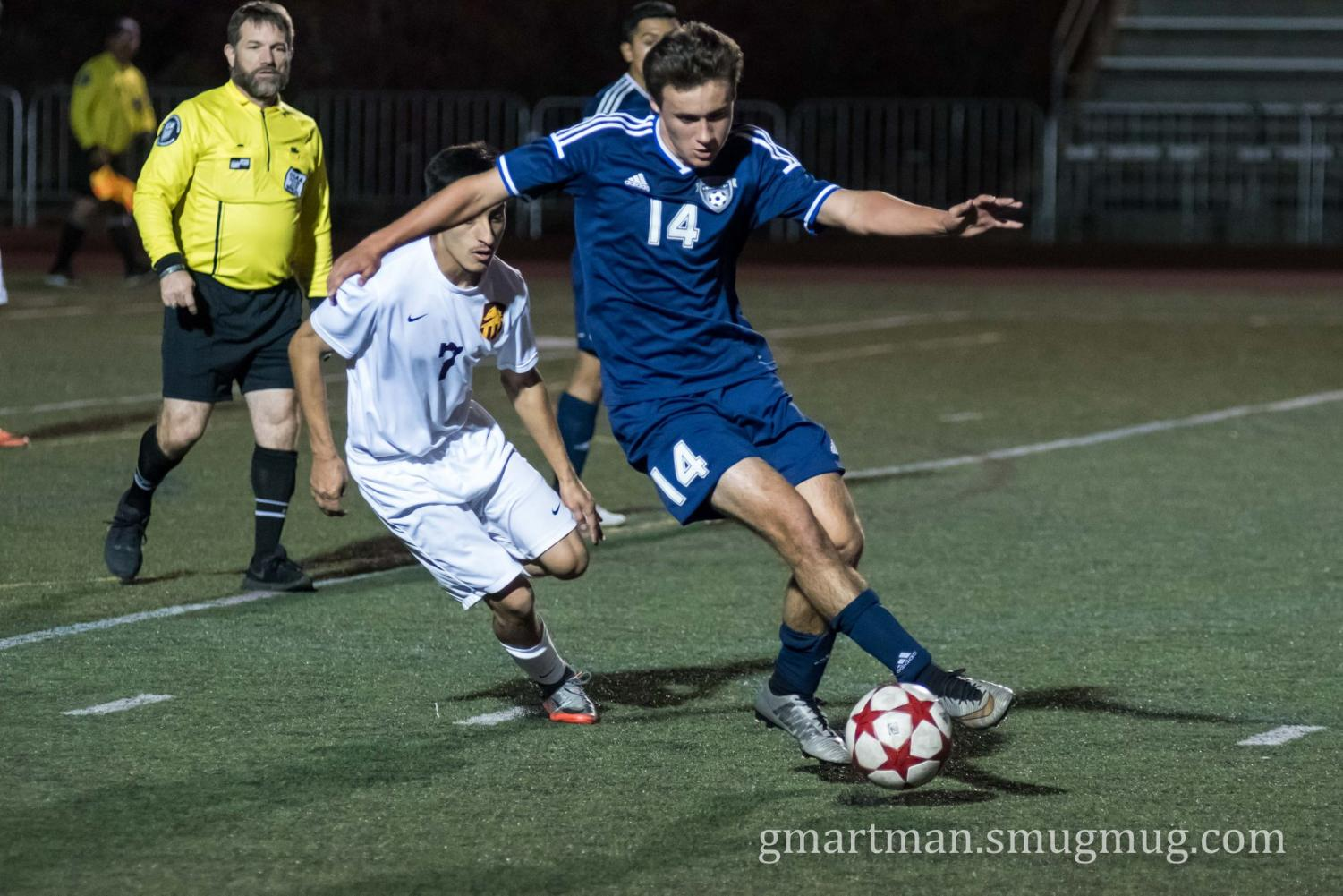 Sam Blohn attacks the ball as the Cats take on the Mustangs.  Blohn scored one of Wilsonville's two goals, but the rally was unsuccessful