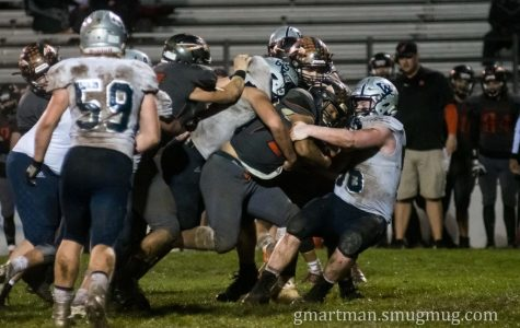 Wildcats take on Scappoose Indians in wet and muddy classic