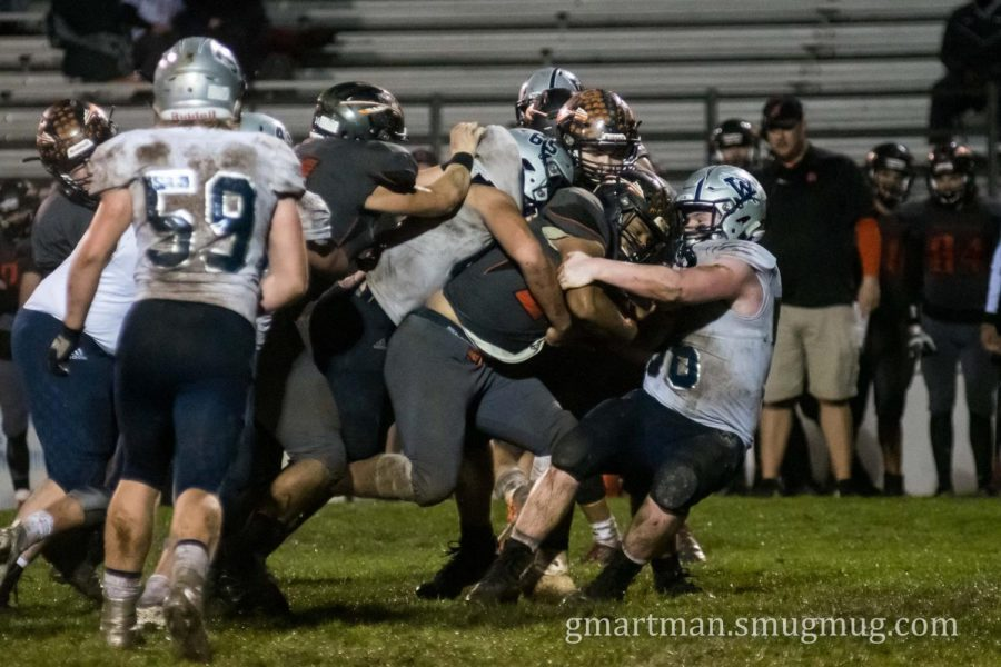 Senior+Caleb+Baker+and+Kalei+Kauhi+gang+up+to+stuff+Scappoose+behind+the+line+of+scrimmage.+On+3rd+on+long%2C+the+Indians+were+forced+to+punt+after+the+tackle+for+a+loss.+