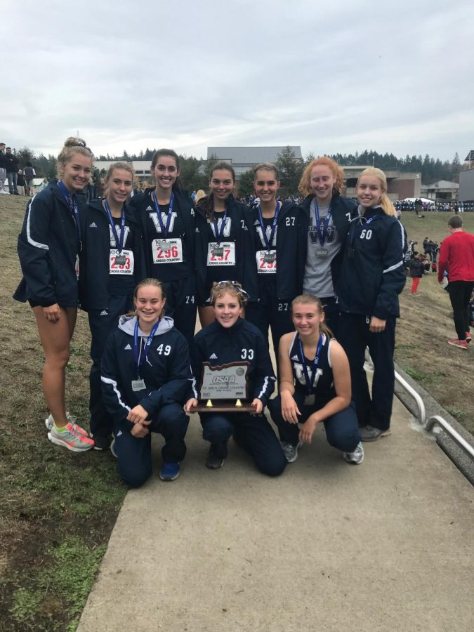 Wilsonville+Cross+Country+girls+pose+with+their+second+place+trophy.+We+are+so+proud+of+how+all+the+athletes+performed+at+state%21