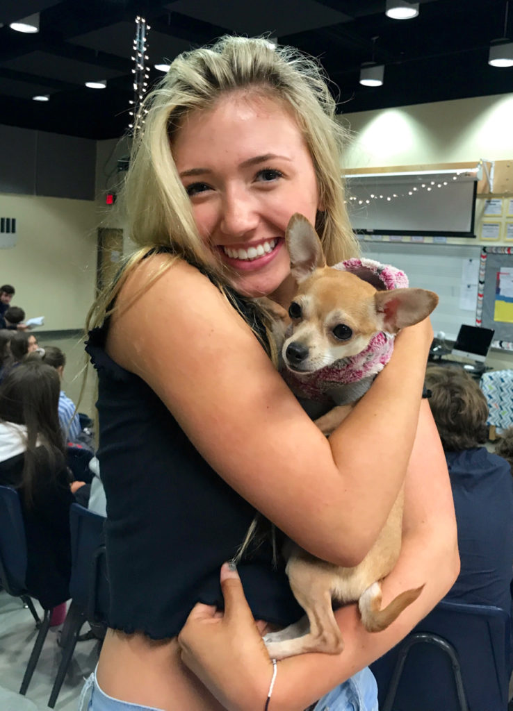 Pictured above is the sophomore Kaiya Shivers who plays Elle Woods in the musical Legally Blonde. She is holding the dog who plays Bruiser Woods.