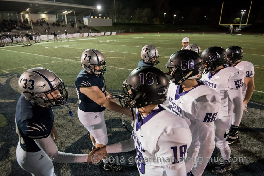 Wilsonville+team+captains+shake+hands+with+Ridgeview+players+before+kickoff.+