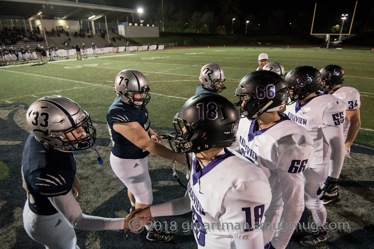 Wilsonville team captains shake hands with Ridgeview players before kickoff.