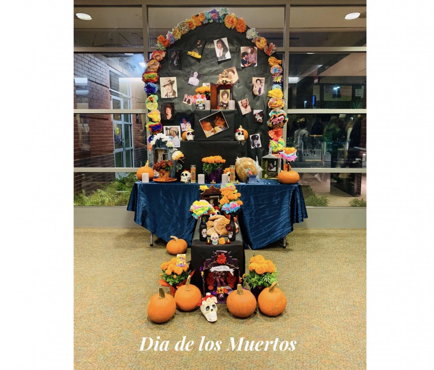 Ofreda featured at the Dia de los Muertos celebration. Guests were welcomed to added pictures to the ofrenda if they wanted to.