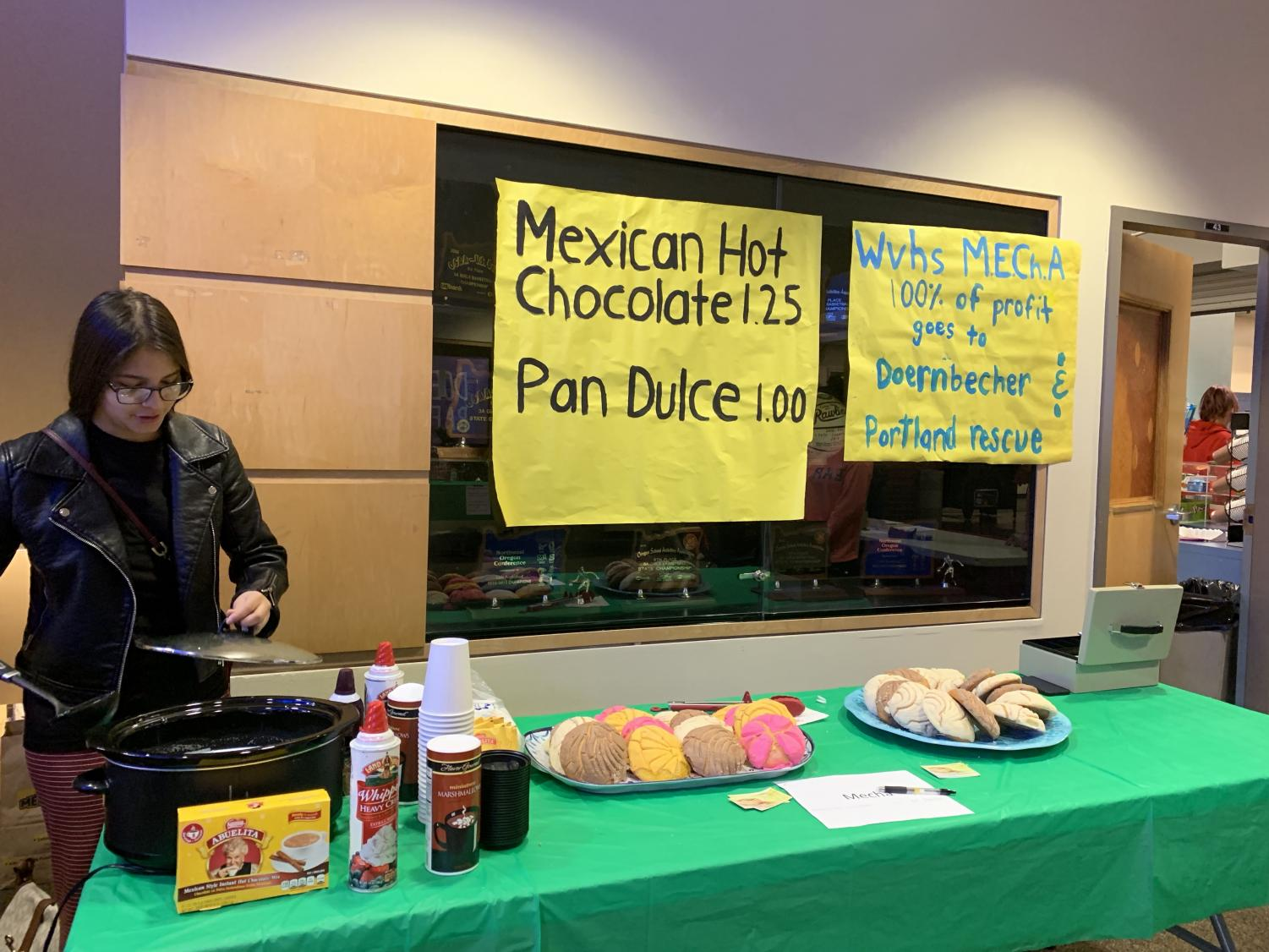 MEChA students at Holiday Bazaar selling hot chocolate and conchas. Proceeds will go to Doernbecher and Portland Rescue.