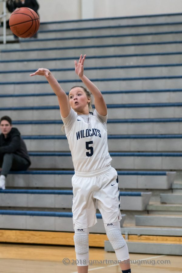 Reese Timm shoots from the three-point line. Timm finished her last season strong.