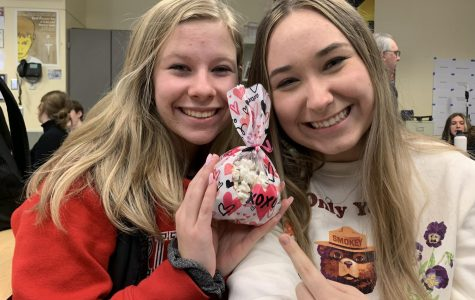 Juniors Meghann Yochim and Aly Johnston celebrate Valentine's Day with a treat.