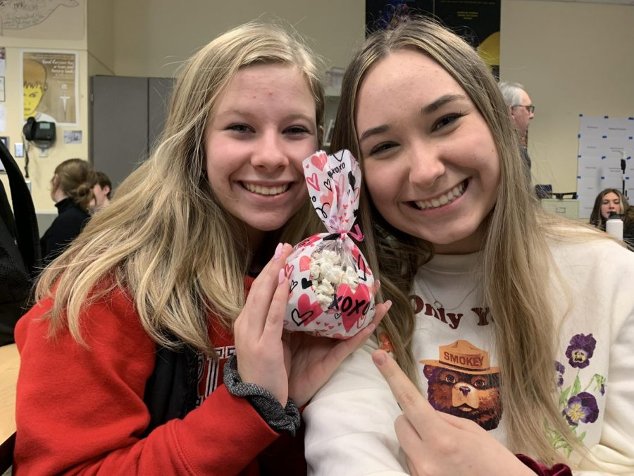 Juniors+Meghann+Yochim+and+Aly+Johnston+celebrate+Valentine%27s+Day+with+a+treat.