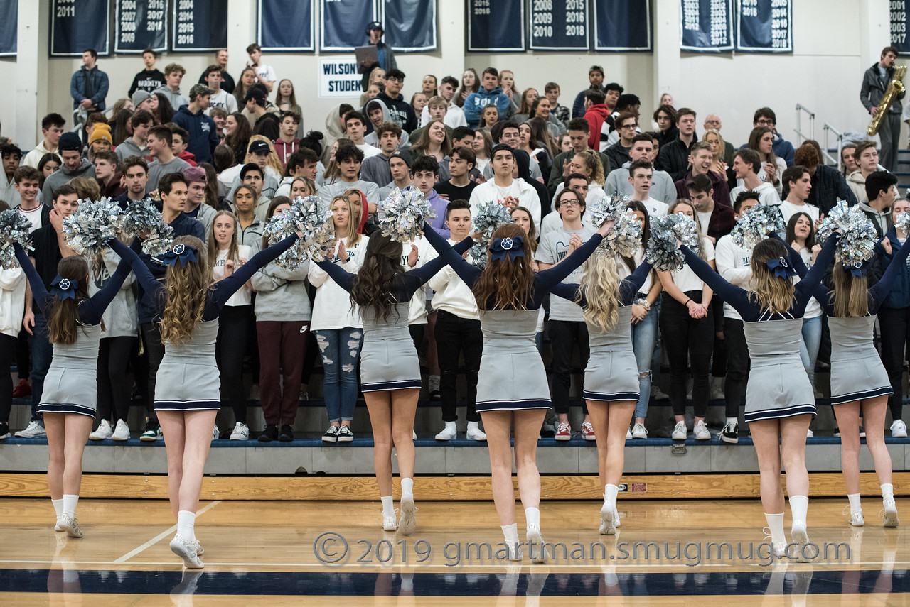 The cheer team roots on the Wildcats. Wilsonville captured the win on senior night.