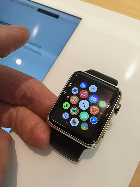A user admires his apple watch