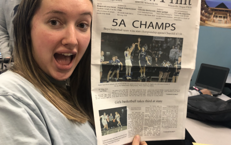 Ally Finkbeiner poses with the newspaper.