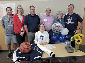 Sophie Bynum beams at her signing ceremony.