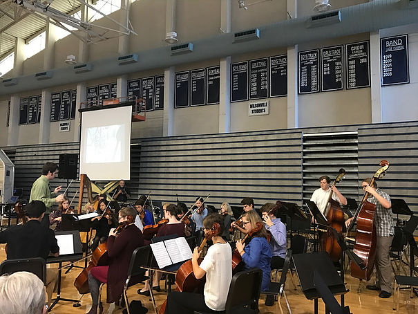 Chad Davies directs the Wilsonville High School orchestra at the fall festival of the arts.