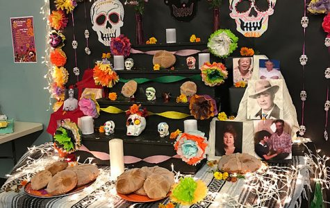 Food and art adorn this Day of the Dead display