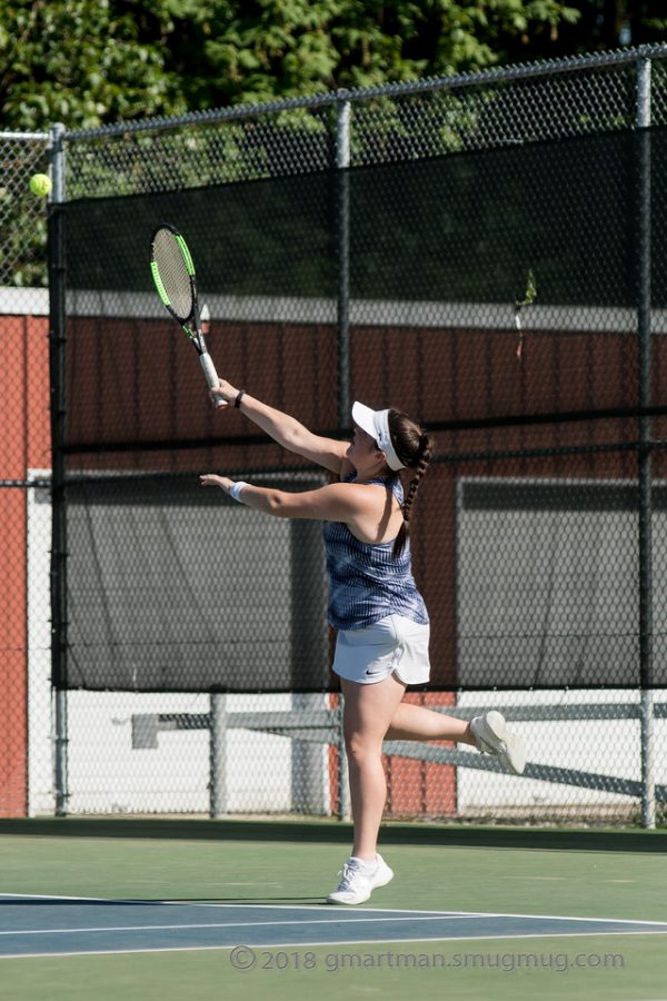 The girls tennis team taking on Mountain View in 2018.