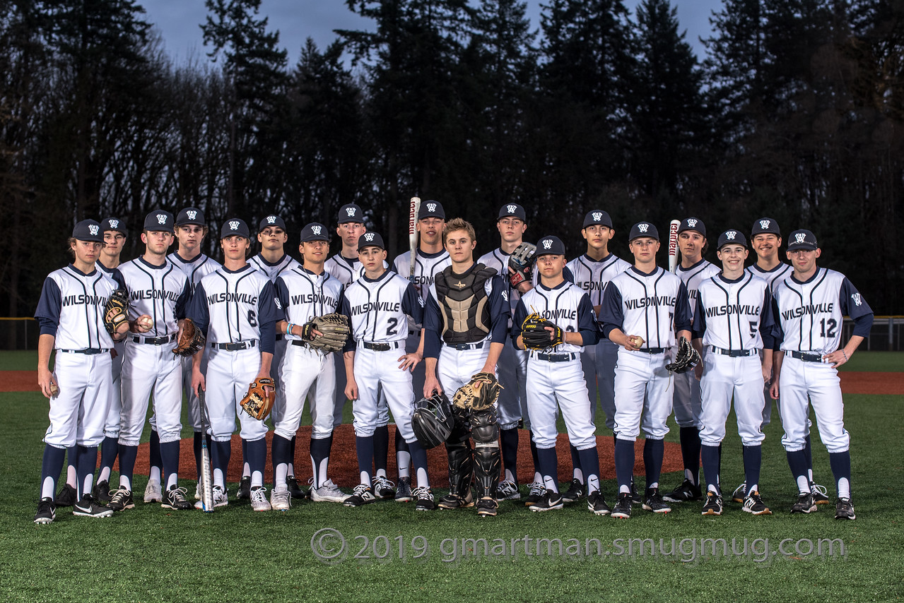 The baseball team poses for a group photo. Credit Greg Artman