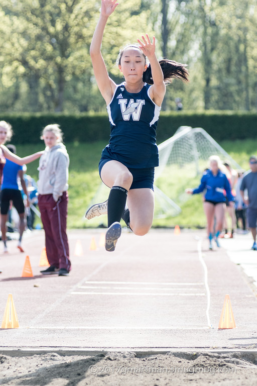 Senior Kellie Yoshida competing in the long jump. She won both the long and triple jump on Wednesday against Milwaukie.