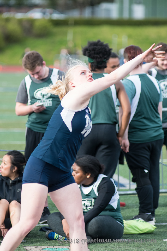 Lauren LaFreniere throwing shot put. She won the event on Wednesday at Scappoose.