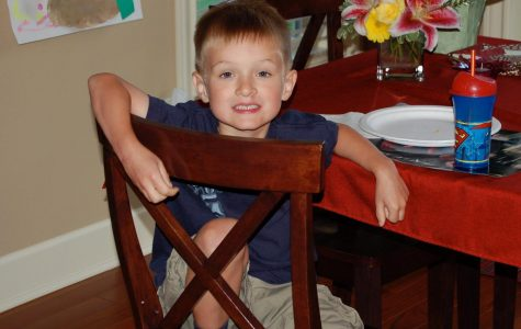 Senior Ryan McCord smiles for the camera on his first day of kindergarten. Photo credit Ryan McCord.
