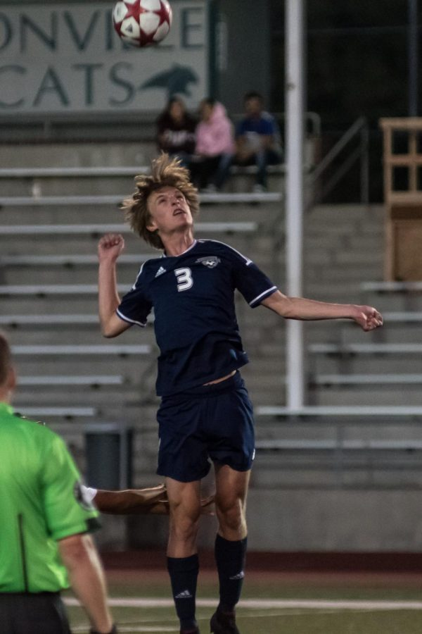 Ryan McCord goes up for a header
