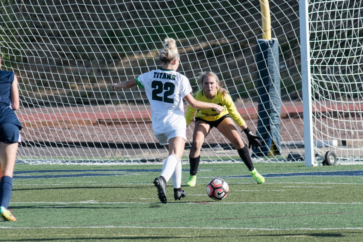 West Salem forward Paige Alexander takes on senior goalie Kendall Taylor. Alexander went on to win the OSAA Athlete of the Week after this performance.
