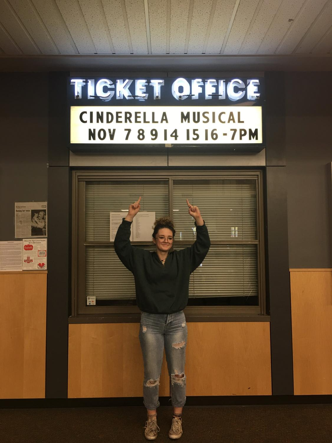 Pictured above is ensemble member Kate Hedgepeth presenting the showtimes for this fall's musical Cinderella.