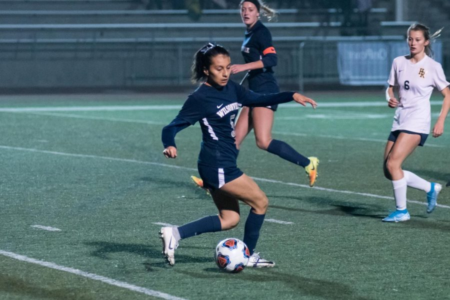 Senior Araxi Martinez dances around the defense. Martinez played a key role in the Wildcats winning league this year.