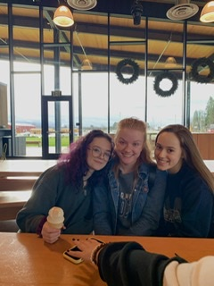 Seniors Kate Hedgepeth, Mikaela Ochocki, and Samantha Katz enjoy a few minutes of down time.  Wilsonville music students worked hard throughout the weekend.