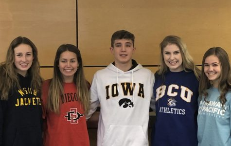 Kennedy Juranek, Brooklyn Waddell, Zach Tiderman, Paige Hinnant, and Julia Huchler pose for a picture after signing their athletic scholarships. Photo credit Emilia Bishop.