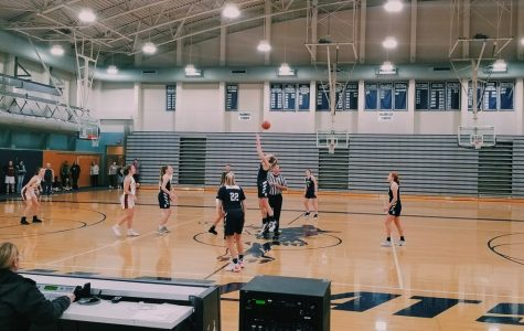 Emi Bishop wins the tipoff for the Wildcats. Wilsonville got the victory in all three of their games in the jamboree on Wednesday night.