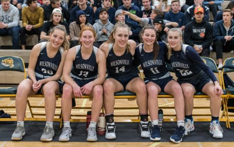 Wilsonville's starters pose before the tipoff. The Wildcat starting five played the majority of the fourth quarter and led the team to the victory over Churchill.