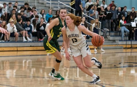 Junior guard Sydney Burns attacks the basket against Putnam. Burns led all scorers with 19 points on Friday night.