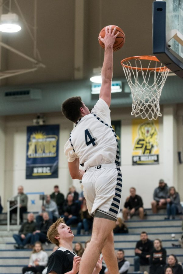 Senior Dakota Reber going up for a dunk, during the second half on this past Friday's game.