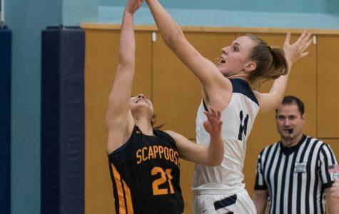 Junior Emi Bishop blocks a shot. The Wildcats held Scappoose under 50 points.