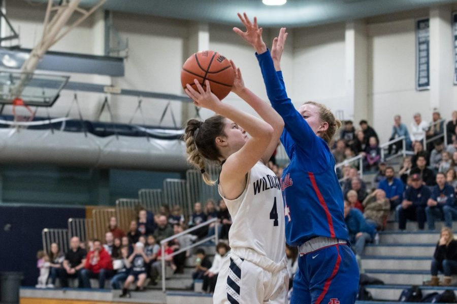 Sophomore Grace Gatto drives against La Salle's Lindsay Drango in the first meeting between the teams, earlier this season. Drango led the Falcons to the victory tonight, splitting the season series 1-1.