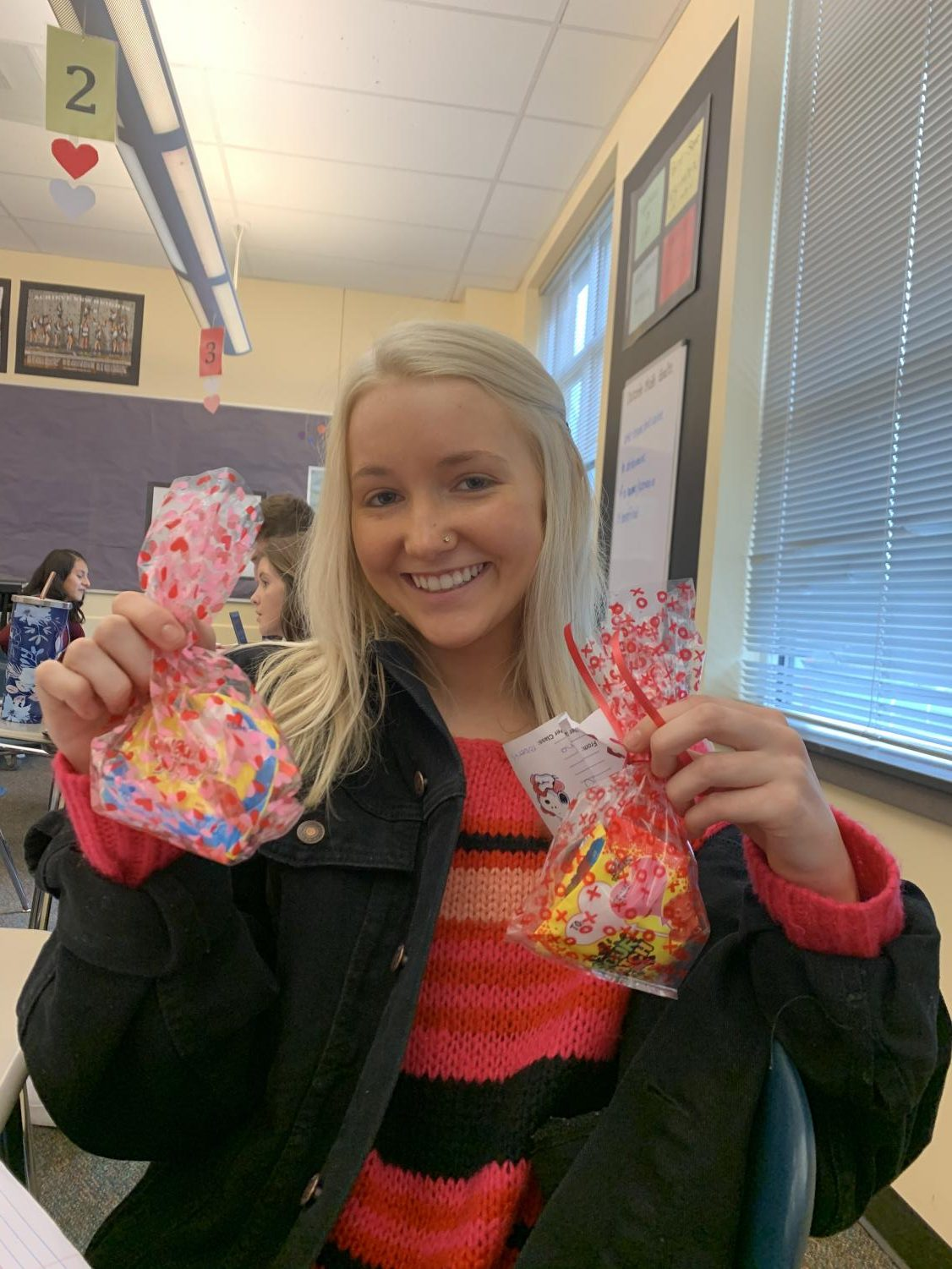 Senior Catie Stamnes holding two candygrams she recieved this Valentine's Day. Photo credit Emily Swenson.