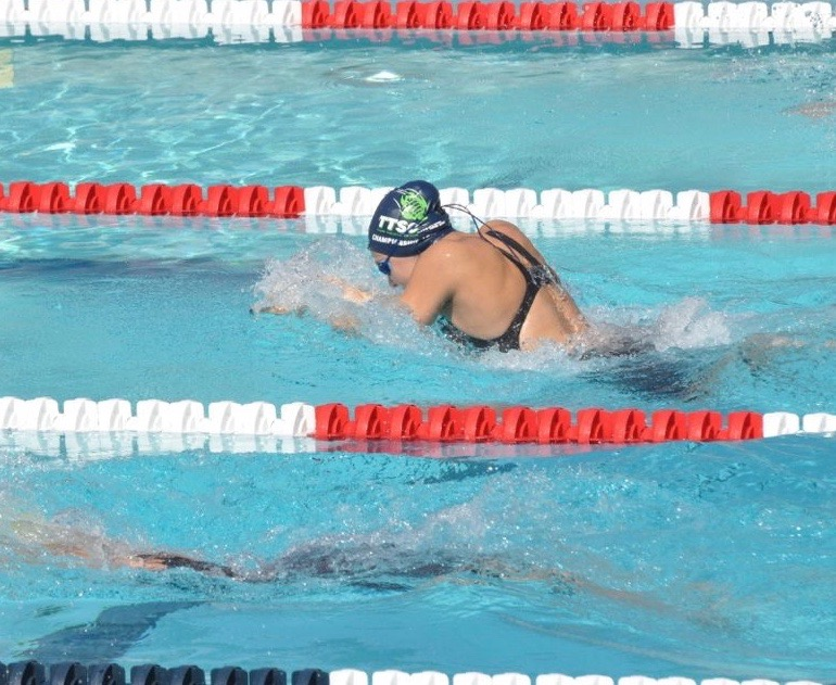 Abby+Maoz+swimming+the+100+meter+breastroke+at+junior+nationals.+Girls+swimming+junior+nationals+was+held+in+Irvine%2C+California.%0A