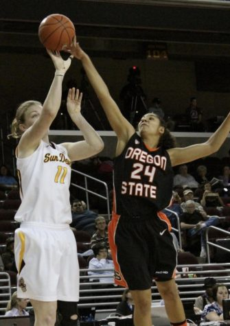 Alyssa Martin blocks a shot from an Arizona State player in the 2011 Pac-12 Tournament. 2011 was Scott Rueck
