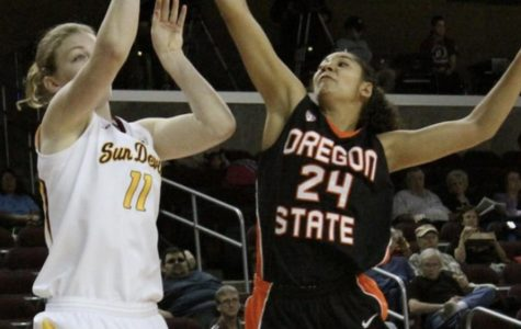 Alyssa Martin blocks a shot from an Arizona State player in the 2011 Pac-12 Tournament. 2011 was Scott Rueck's first of ten years at Oregon State.