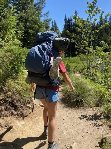 Junior Ellie Wettstein exploring Oregon on a hike in Mirror Lake. Students have been using hiking as a way of staying in touch while social distancing.