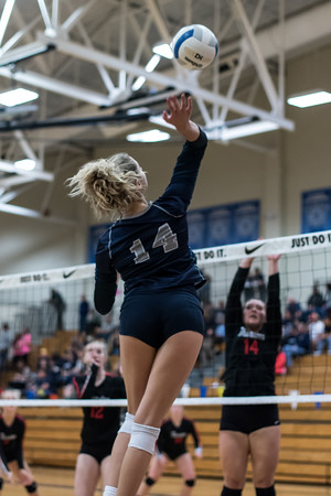 Clarissa Klein spiking the ball against Thurston. She will continue her volleyball career into College.