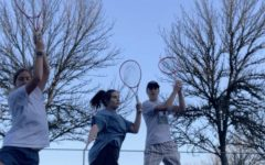This is a picture from one of the many times Lauren Bresnahan played tennis. She is pictured with Wilsonville students Gabby Prusse and Shane Bresnahan.