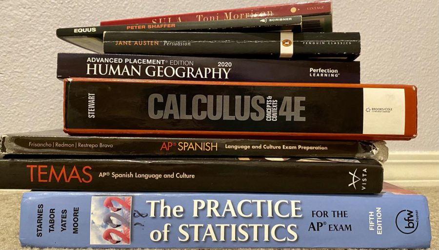 Maura Schramm's stack of AP materials that she is using to prepare for  AP tests. Students need to balance all these classes during their off quarter in order to pass their AP tests come spring.