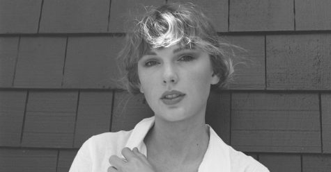 """Artist of the decade Taylor Swift, known for changing her aesthetics often, maintains her soft, woodsy look or her ninth album """"evermore."""" Her fans claim that her second surprise album may be her best work yet."""