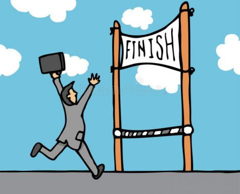 Man reaching the finish line. Photo belongs to @Dreamstime